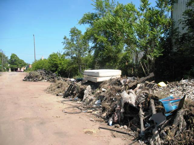 Piles of debris cleared from vacant lots in Detroit