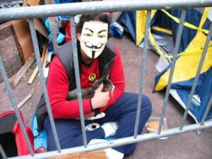 Masked protestor strokes his cat.