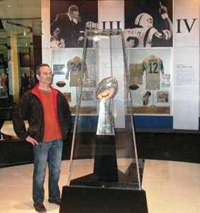 Tracy inspects the Lombardi Trophy