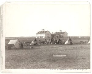 Teepees before an Indian boarding school.