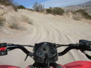 Driving an ATV in the sand dunes near Palm Springs.