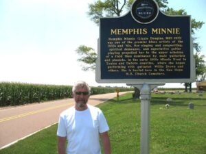 Malcolm Logan at the Memphis Minnie Blues Marker sign near her grave.