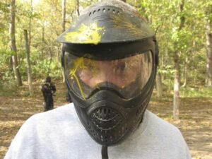 Malcolm Logan wearing a paintball mask.