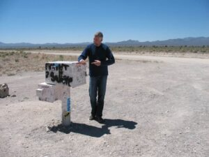 Malcolm Logan at the black mailbox near Area 51