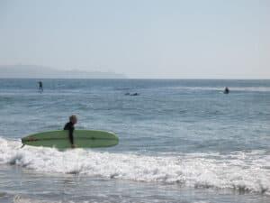 Surfers at Campus Point in Santa Barbara, CA