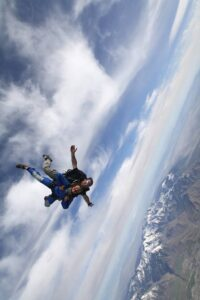 Cambelle Logan skydiving over the Wasatch Mountains in Erda, Utah