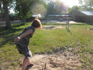 Marianne Grisdale tosses a horseshoe
