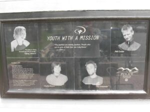Plaque honoring the dead and injured outside the Youth with a Mission Training Center in Arvada, CO