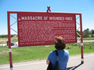 Explanatory sign at Wounded Knee massacre site