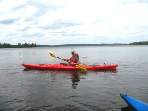 Malcolm Logan kayaking at Pehrson Lodge near Cook, Minnesota