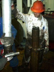Oil field worker pulling Bakken core