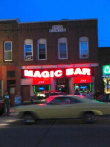 A GTO powers past the Magic Bar in Virginia, MN