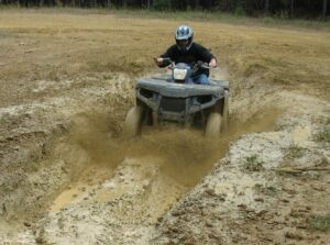 Malcolm Logan attacking a mud slough at Carolina Adventure World in Winnsboro, South Carolina