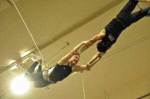Malcolm Logan being caught by Kris of New York Trapeze School in Chicago