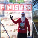 Malcolm Logan dressed as Santa Claus at the Santa Hustle 5K in Chicago