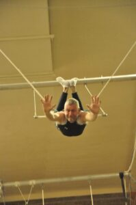 Malcolm Logan on the trapeze at New York Trapeze School in Chicago