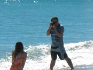Photographer and model on Miami Beach
