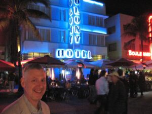 Malcolm Logan in front of the art deco hotels on Ocean Drive in Miami Beach