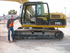Malcolm Logan with excavator at Dig This Heavy Equipment Playground
