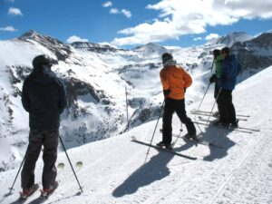 Four skiers getting ready to drop into the Black Iron Bowl at Telluride