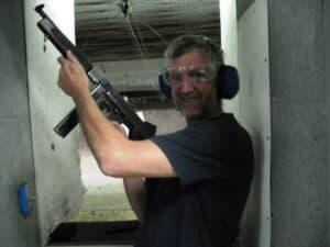 Holding a machine gun at The Gun Store in Las Vegas
