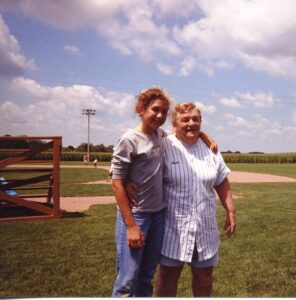 My daughter with the friendly souvenir lady at The Field of Dreams in 1999.