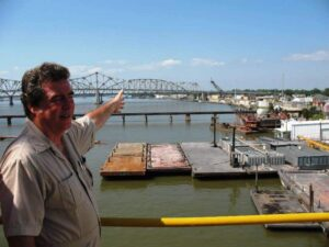 Guide points to Morgan City from the deck of the oil rig