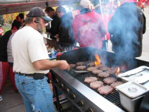 Grilling burgers at the Buckeye tailgate party.
