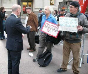 A Wall Street type debates with the Occupy Wall Street protestors.