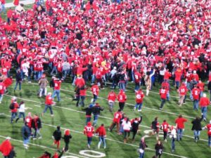Fans rush onto the field after the Buckeyes upset Wisconsin.