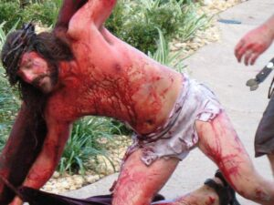 A bloody Jesus stumbles under his cross at the Holy Land Experience.