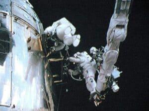 Two astronauts repair the Hubble telescope in the film Hubble