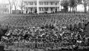 Assembled student body at the Carlisle Institute Indian boarding school.