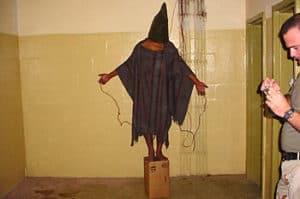 Prisoner being tortured at Abu Ghraib
