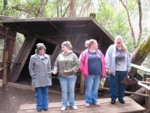 Four women Oregon Vortex height illusion