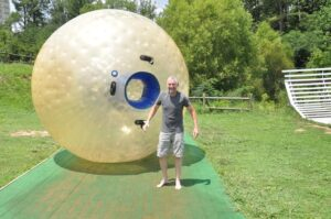 Malcolm Logan standing outside a Zorb ball.