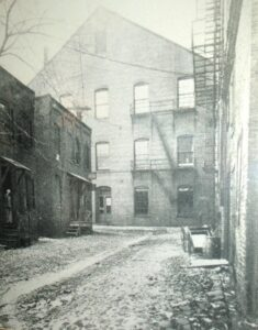 The alley behind Ford's Theater as it appeared in 1865 when Booth escaped down it.