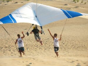 Malcolm Logan hang gliding with Kitty Hawk Kites at Jockey Ridge State Park.