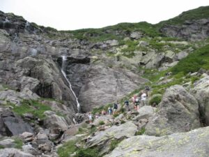 Hikers ascending toward The Headwall of Tuckerman Ravine.
