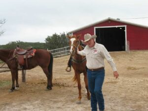 Doug leading Colton out of the barn at the Running R Ranch in Bandera, TX