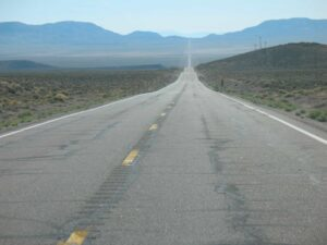 A long stretch of open road in the Nevada desert