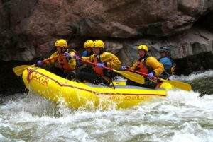 Navigating Wall Slammer rapids on the Arkansas River in the Royal Gorge