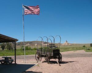 Chimney rock with wagon and American flag