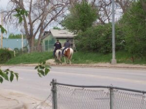Two riders at the Pine Ridge Indian Reservation