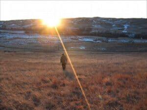 Sioux man walks toward the sunset on the Pine Ridge Indian Reservation