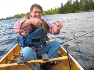 Tim Lincoln catches as a rock bass.