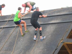 Malcolm Logan on the Giant Cliffhanger at the Warrior Dash in Grand Rapids, MI