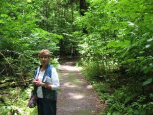 Adele Bowen in the forest at Lily Dale