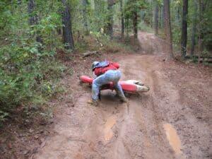 Randy Gray picks up his bike after falling off at Carolina Adventure World