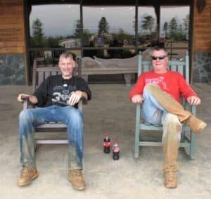 Malcolm Logan and Randy Gray sitting on the porch at Carolina Adventure World